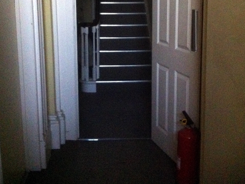 Fire extinguisher moonlighting as door stopper?