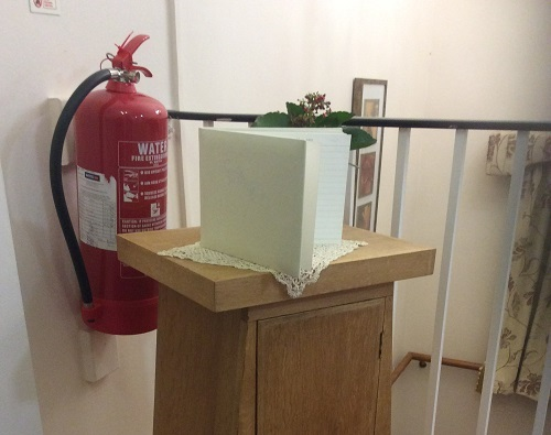 Guest book pulpit blocks fire extinguisher